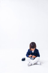 Portrait of funny little boy with cute outfit playing with camera.