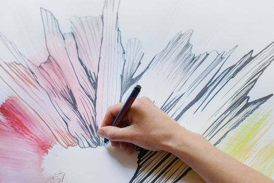 Close Up of Female Hand Drawing Original Artwork With Black Felt Pen