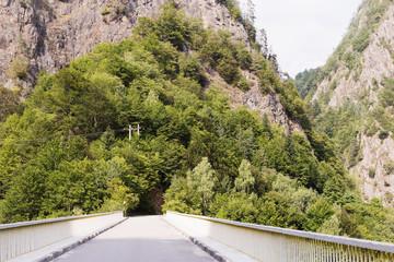 Fagaras mountains and bridge with tunnel on the road Transfagarasan. Romaina
