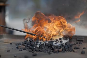Blacksmith preparing fire for work