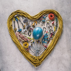 Climbing gear in a heart shape made with rope