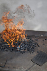 Burning fire at fireplace in workshop
