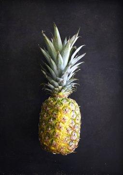 Pineapple on simple black background