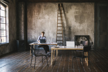 Businessman working in a contemporary loft office