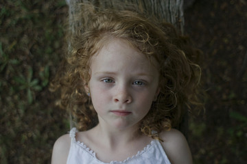 Portrait of a little red haired girl