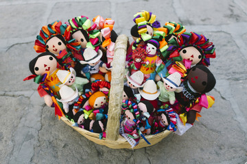Basket full of mexican dolls