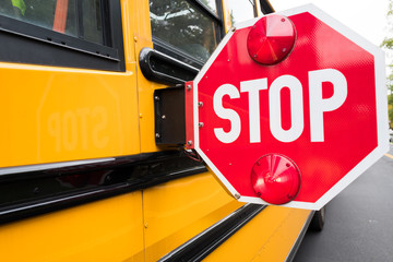 school bus stop sign on side of bus