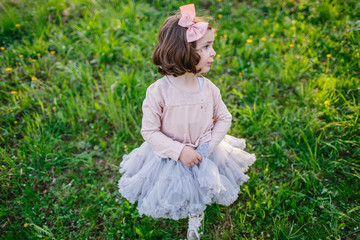 little girl is played in cherry orchard