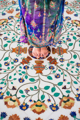 Woman Barefoot Standing On Floral Floor