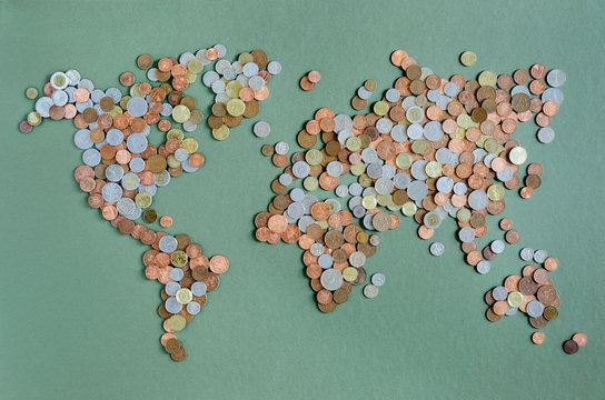 Overhead view of world map made up of coins