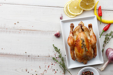 Roasted chicken with herbs and spices for Christmas or Thanksgiving holiday dinner, top view