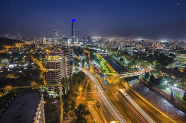 Fotomurales - Night view of Santiago de Chile toward the east part of the city, showing the Mapocho river and Providencia and Las Condes districts
