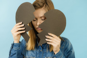 Young woman with broken heart