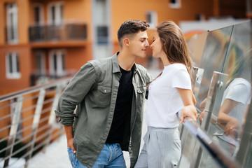 Couple hug and kissing dating on bridge
