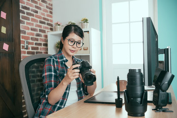 picture business woman holding professional camera