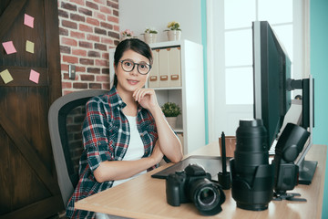 woman right sitting in photo editing office