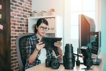 female designer lady sitting on working desk
