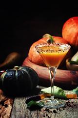 Halloween orange cocktail on a dark festive background, selective focus