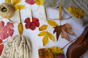 autumn sale in clothing stores in the season of autumn, on a rope hanging autumn leaves instead of clothes