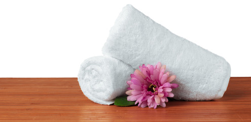 flower with stack of white towel