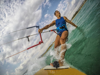 Young man practice kitesurfing. Action camera on board view