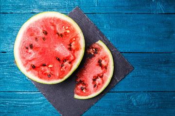 Photo of cut watermelon in wooden table