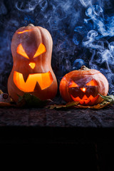 Picture of two halloween pumpkins on black background