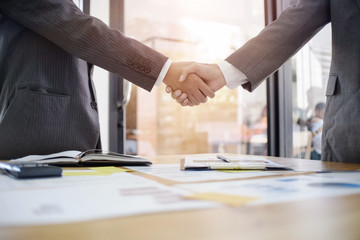 Business Partnership concept. businessman shaking hands finishing up a meeting,acquisition concept.