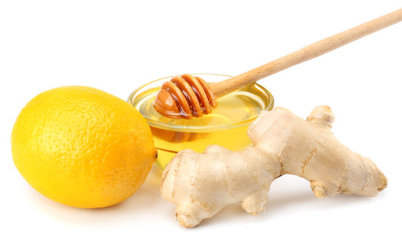 healthy background. ginger with lemon and honey isolated on white background close up