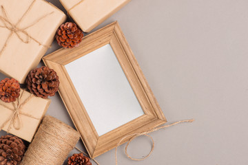 Christmas or New year gift boxes collection wrapped in kraft paper and blank photo frame for text.