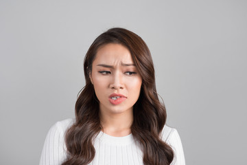 A portrait of young asian woman with annoyed face