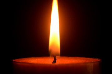 Single lit candle with quite flame