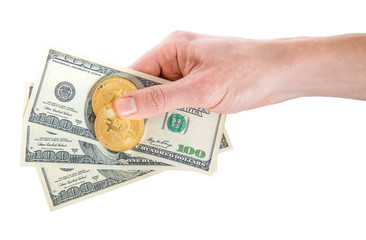 two golden Bitcoin on US dollars in a man hand. Digitall symbol of a new virtual currency.Electronic money exchange concept.