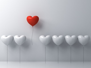 Stand out from the crowd and different concept , One red heart balloon flying away from other white heart balloons on white wall background with window reflections and shadows . 3D rendering.