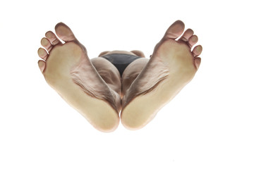 feminine feet from below with the load points