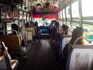 Inside a bus, public transportation in Bangkok, Thailand