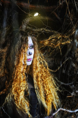 the witch in the dark forest on Halloween