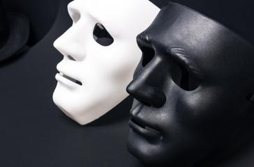 White and dark human masks