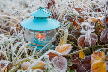 Christmas decoration with lantern and snow on wooden desk. Winter background.