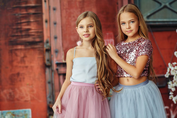 Little girls with wavy hair posing