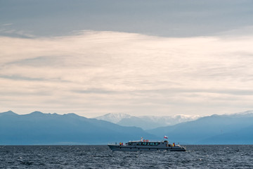 Passenger boat sails on Lake Baikal