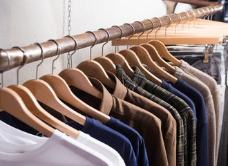 different colored clothes in the modern shop