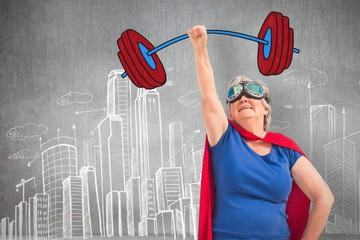 Composite image of senior woman disguise as superhero with hand