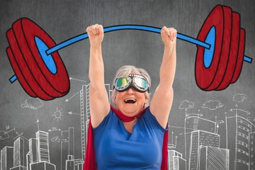 Composite image of senior woman pretending to be a superhero