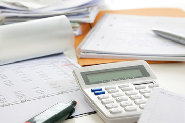 Close-Ups of Desk depicting different occupations professions: Account / Tax consultant