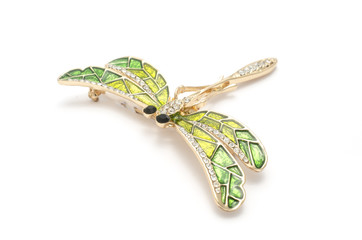 Wall Mural - enamel brooch with golden dragonfly with diamonds isolated on white