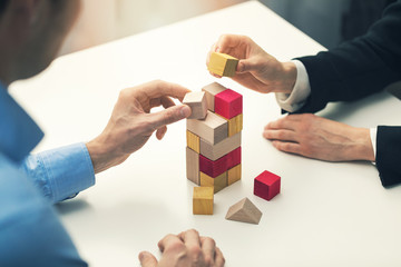 business cooperation and partnership concept - businessmen working together