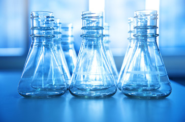 blue clear glass flask in medical science laboratory background