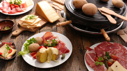 raclette cheese with potato and salami