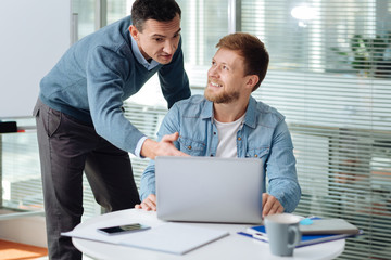 Insistent office worker pointing at mistake